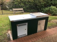 Custom double gas BBQ cabinet with front access door